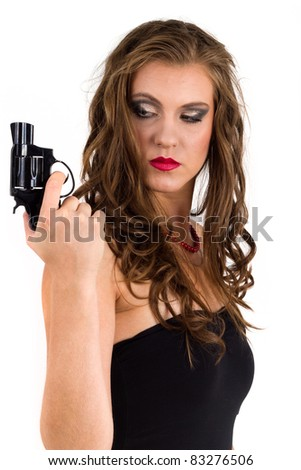 Woman holding a gun - stock photo