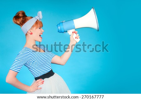 Woman holding a megaphone on blue background  - stock photo
