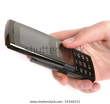 Woman holding a mobile phone in the hand - stock photo