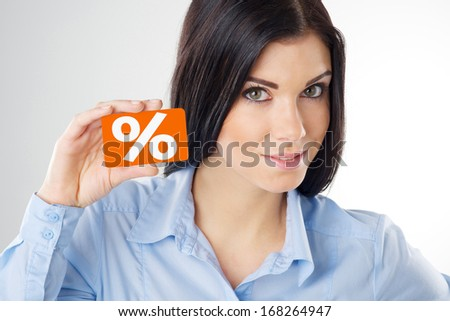 woman holding a orange card - stock photo