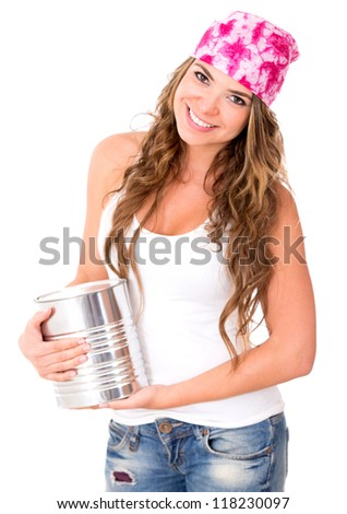 Woman holding a paint can - isolated over a white background - stock photo