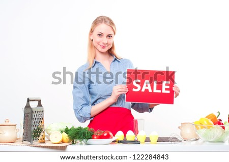 woman holding a plate with an inscription Sale - stock photo