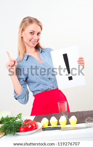 woman holding a plate with exclamation mark - stock photo