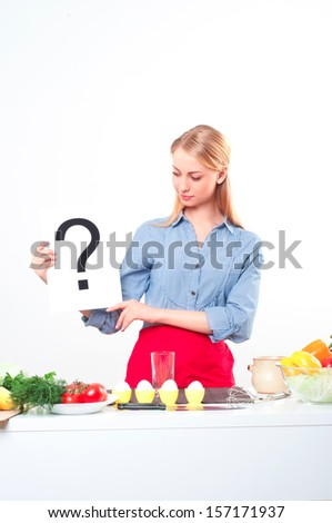 woman holding a plate with question mark - stock photo