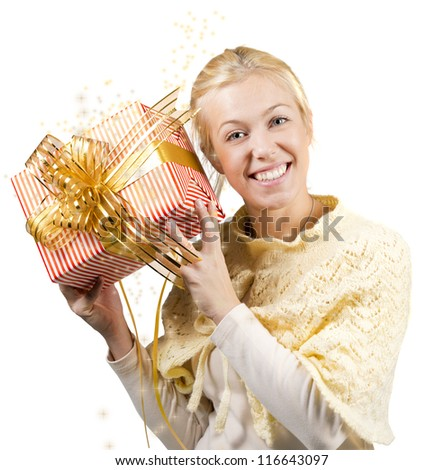 Woman holding a present  over a white background - stock photo