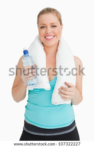 Woman holding a towel around her neck against white background - stock photo