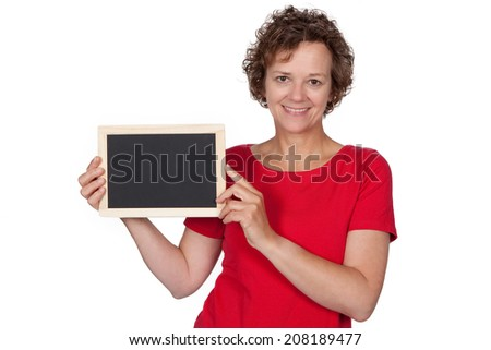 Woman holding al blackboard in her hands - stock photo