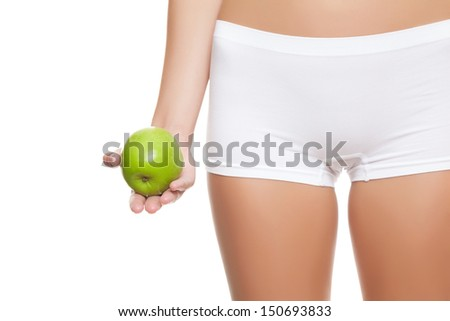 Woman holding an apple without signs of cellulitis - stock photo