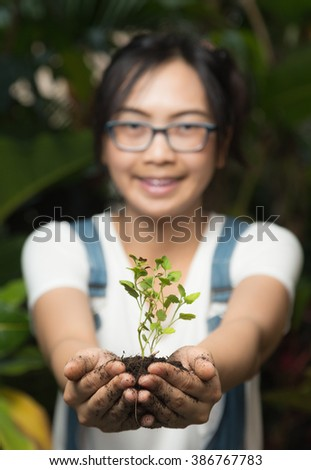 Woman holding and caring for trees. Maintaining the natural tree. Environmental in nature - stock photo