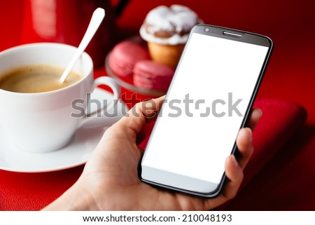 Woman holding big cellphone for reading or sending message on copy space screen at breakfast with coffee in restaurant. - stock photo