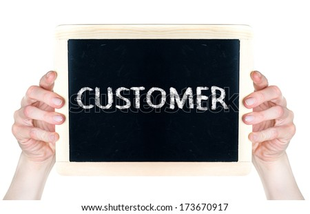 Woman holding blackboard with word Customer - stock photo