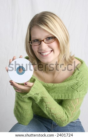 Woman holding blank CD - stock photo