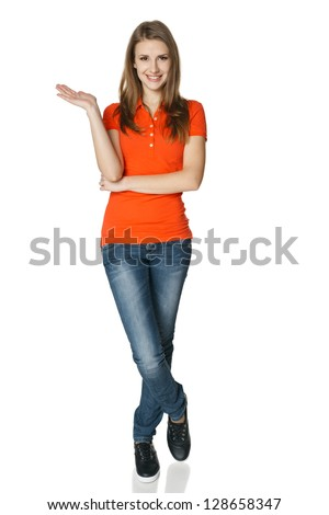 Woman holding blank copy space on her open palm standing in full length, isolated on white background - stock photo