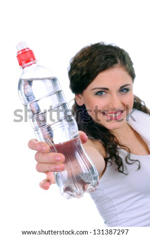 woman holding bottle with water over white background - stock photo