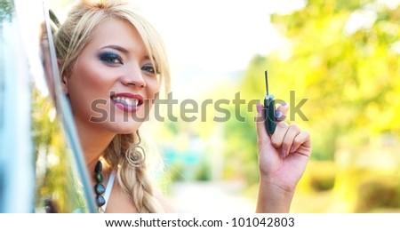 Woman holding car key - stock photo