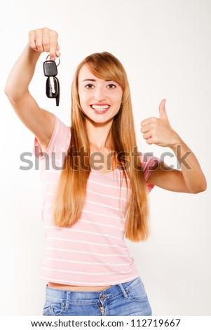 woman holding car keys she is happy - stock photo