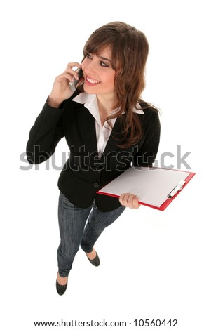 Woman holding clipboard, smiling - stock photo