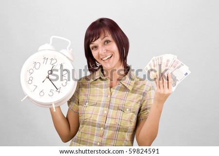 Woman holding clock and money, in gray background - stock photo
