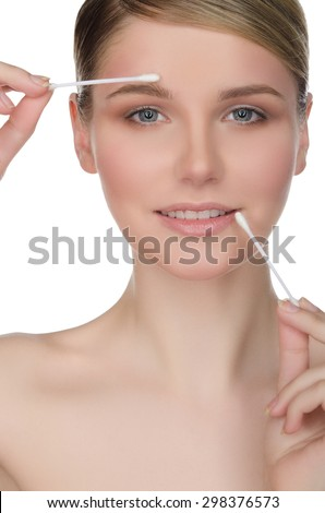woman holding cotton swabs in mouth and eyes isolated on white - stock photo