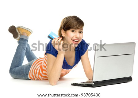 Woman holding credit card using laptop - stock photo