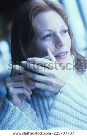 Woman holding cup of tea - stock photo