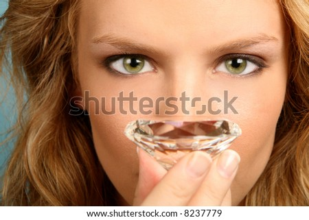 Woman Holding Diamond With High Depth of Field - stock photo
