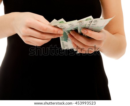 Woman holding different banknotes isolated on white - stock photo