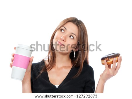 Woman holding donut and coffee in hand. Morning breakfast food concept isolated on a white background - stock photo