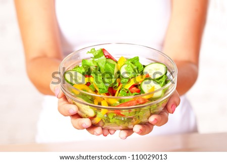 woman holding  fresh  salad in glass boil - stock photo