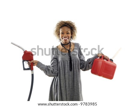 Woman holding fuel pump nozzle and gas storage container. - stock photo