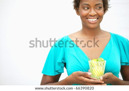Woman holding glass of lemons - stock photo