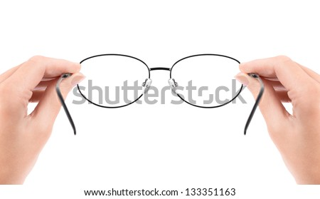 Woman holding glasses in hands. Isolated on white. - stock photo