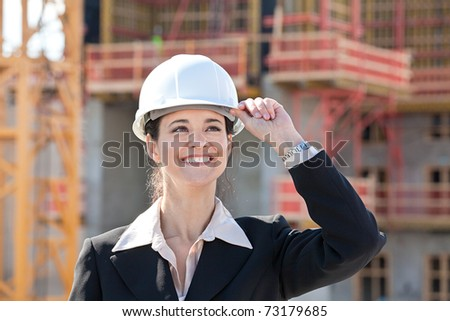 Woman holding hard hat - stock photo
