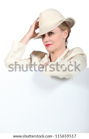 Woman holding hat - stock photo