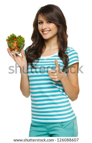Woman holding healthy salad meal and showing thumb up sign, over white - stock photo