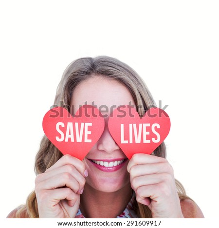 Woman holding heart cards against save lives - stock photo