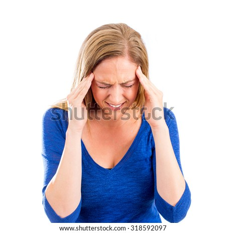 Woman holding her head in pain with headache - stock photo