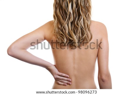 Woman holding her painful back - stock photo