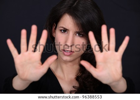 Woman holding her palms up - stock photo