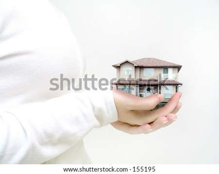 Woman holding house. Its not a model, it - stock photo