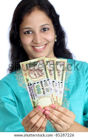 Woman holding Indian currency notes - stock photo