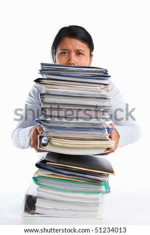 Woman holding lot of paper, concept for heavy workload - stock photo