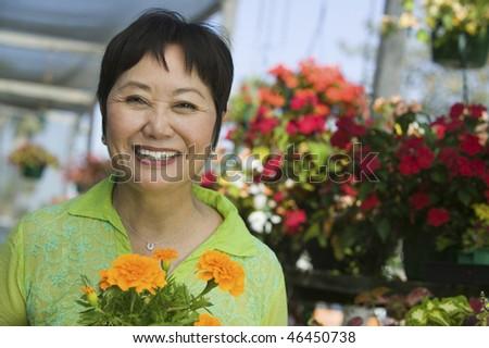 Woman Holding Marigolds - stock photo