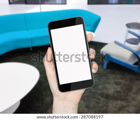 Woman holding mobile phone in her hand - stock photo