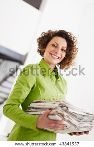 woman holding newspapers for recycling. Copy space - stock photo