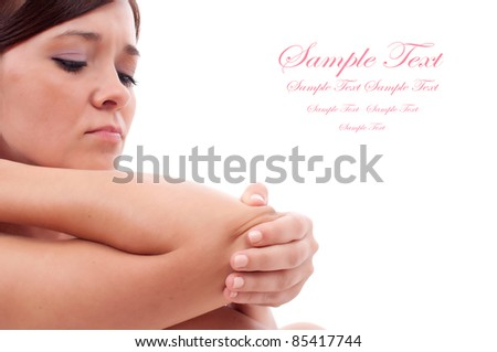 Woman holding painful elbow - stock photo