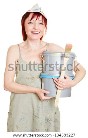 Woman holding paint buckets and brush for renovation - stock photo