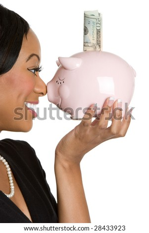 Woman Holding Piggy Bank - stock photo