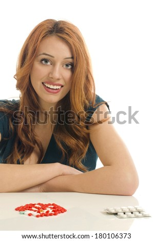 Woman holding pills that will cure her illness. Woman using pills for her diet,  vitamins - stock photo