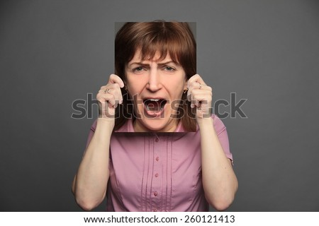 woman holding poster with emotion - stock photo